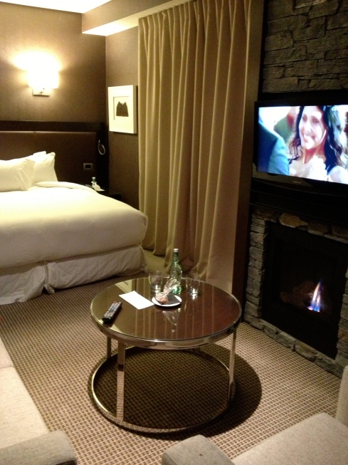Inside the room, complete with open fire